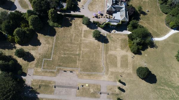 Aerial view of mansion site and parchmarks, July 2018 © National Trust